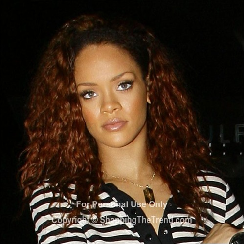 Rihanna new dark red hair color in Los Angeles on July 28th