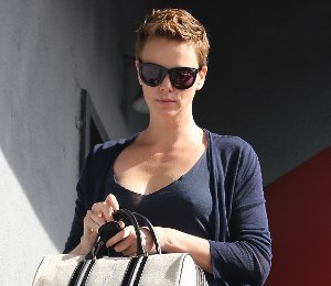Charlize Theron & Givenchy Lucrezia Duffel Bag - in LA on Feb 1