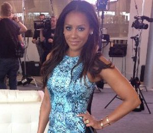 Mel B blue animal print dress at X Factor auditions by Nicholas