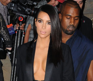 Kim Kardashian cleavage in Lanvin open jacket at Paris Fashion Week