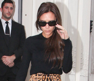 Victoria Beckham chic in Balmain leopard skirt at her new Dover Street store!