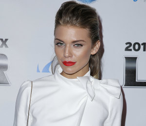 AnnaLynne McCord white jacket & black skirt at Super Bowl Party!