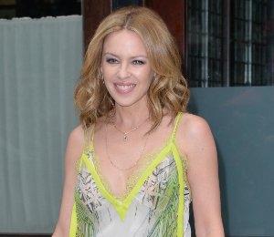 Shop Kylie Minogue Roberto Cavalli yellow print top & trousers in New York