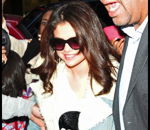 Image showing Shop Selena Gomez Wildfox Love skull sweater & denim coat - in NY on Nov 12