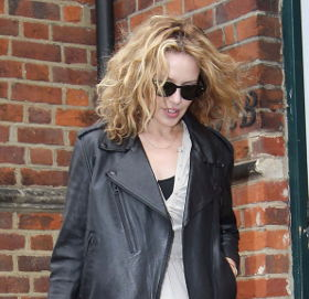 Image showing Street Chic: Buy Kylie Minogue black leather fringe jacket online & 30% off voucher from My-Wardrobe!
